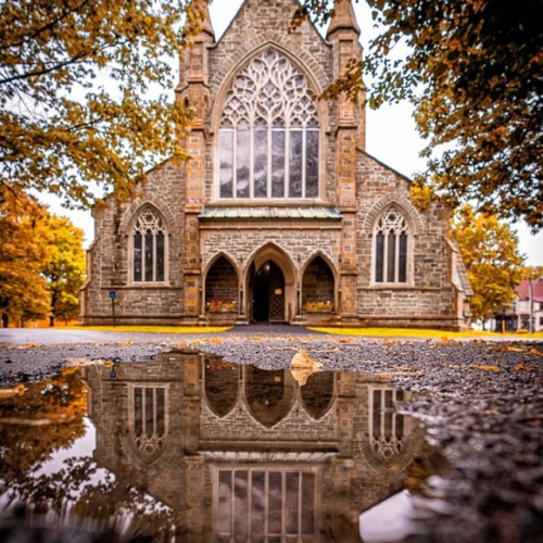 A reflection of this nice temple of the Anglican Church in New Brunswick, in the season of leaves changing colours. A delightful architecture. . . . #newbrunswick #fredericton #canada #canada #sonyalpha #a7m3 #tourism #travel #cdr35 #anglicanchurch #sony1